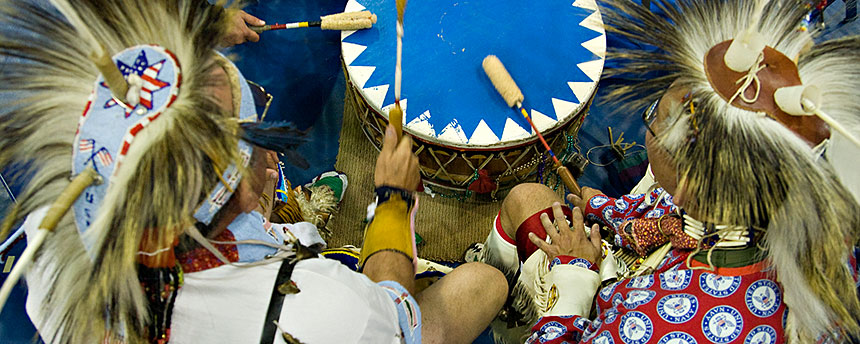 Native Americans beat a drum at the annual Powwow