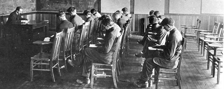 Students sit in English class from the early 20th century