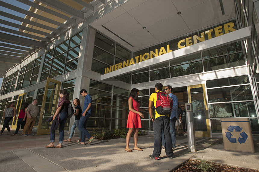 People standing in front of the International Center